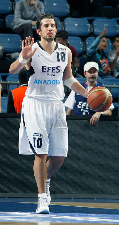 Efes Pilsen's Kerem TUNCERI during their Turkish Basketball league match Efes Pilsen between Olin Edirne at the Sinan Erdem Arena in Istanbul Turkey on Friday 06 May 2011. Photo by TURKPIX
