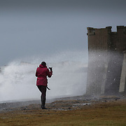 Storm Gertrude. Ayrshire Coast.  A woman has a stroll along the shore at Ardrossan. Picture Robert Perry 29th Jan 2016<br /> <br /> Must credit photo to Robert Perry<br /> FEE PAYABLE FOR REPRO USE<br /> FEE PAYABLE FOR ALL INTERNET USE<br /> www.robertperry.co.uk<br /> NB -This image is not to be distributed without the prior consent of the copyright holder.<br /> in using this image you agree to abide by terms and conditions as stated in this caption.<br /> All monies payable to Robert Perry<br /> <br /> (PLEASE DO NOT REMOVE THIS CAPTION)<br /> This image is intended for Editorial use (e.g. news). Any commercial or promotional use requires additional clearance. <br /> Copyright 2014 All rights protected.<br /> first use only<br /> contact details<br /> Robert Perry     <br /> 07702 631 477<br /> robertperryphotos@gmail.com<br /> no internet usage without prior consent.         <br /> Robert Perry reserves the right to pursue unauthorised use of this image . If you violate my intellectual property you may be liable for  damages, loss of income, and profits you derive from the use of this image.