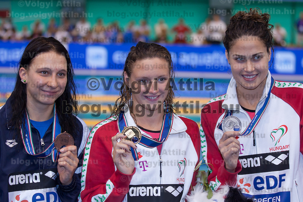 Bronze medalist Barbora Zavadova (L) of Czech Republic, gold medalist Katinka Hosszu (C ) of Hungary  and Zsuzsanna Jakabos (R ) of Hungary celebrate their victory during the Women's 400m Individual Medley final of the 31th European Swimming Championships in Debrecen, Hungary on May 21, 2012. ATTILA VOLGYI