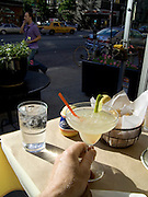 Sitting with a margarita and looking out over New York City street