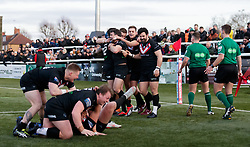 London Broncos' Elliot Kear celebrates with his teammates after scoring the final try of the match during the Betfred Super League match at Trailfinders Sports Club, London.