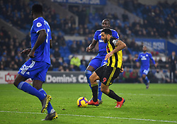 Watford's Troy Deeney (right) scores his side's fourth goal of the game during the Premier League match at the Cardiff City Stadium.
