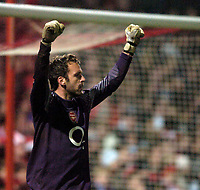Photo: Jed Wee.<br /> Doncaster Rovers v Arsenal. Carling Cup. 21/12/2005.<br /> <br /> Arsenal goalkeeper Manuel Almunia celebrates his save from Doncaster's Neil Roberts.