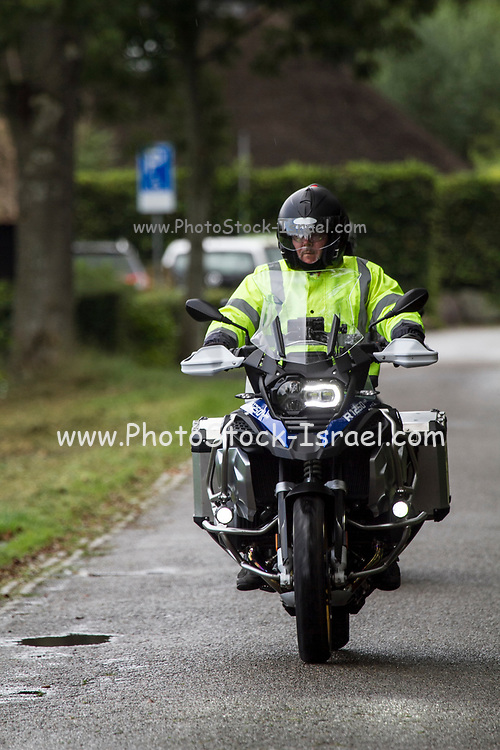 Motorcyclist Photographed in Giethoorn a town in the province of Overijssel, Netherlands It is located in the municipality of Steenwijkerland, about 5 km southwest of Steenwijk. As a popular Dutch tourist destination both within Netherlands and abroad,