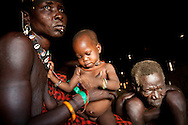 The chief of a village near Boma with his wife and last child. One of their children was abducted by a neighboring tribe.