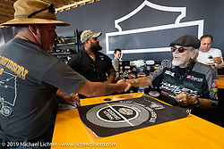 Willie G Davidson signing autographs in the Harley-Davidson Garage at the Full Throttle Saloon during the Sturgis Black Hills Motorcycle Rally. Sturgis, SD, USA. Tuesday, August 6, 2019. Photography ©2019 Michael Lichter.