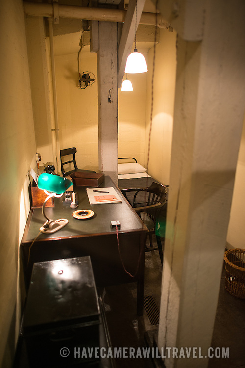 Room 61A Left, the private secretary's office, at the Churchill War Rooms in London. The museum, one of five branches of the Imerial War Museums, preserves the World War II underground command bunker used by British Prime Minister Winston Churchill. Its cramped quarters were constructed from a converting a storage basement in the Treasury Building in Whitehall, London. Being underground, and under an unusually sturdy building, the Cabinet War Rooms were afforded some protection from the bombs falling above during the Blitz.