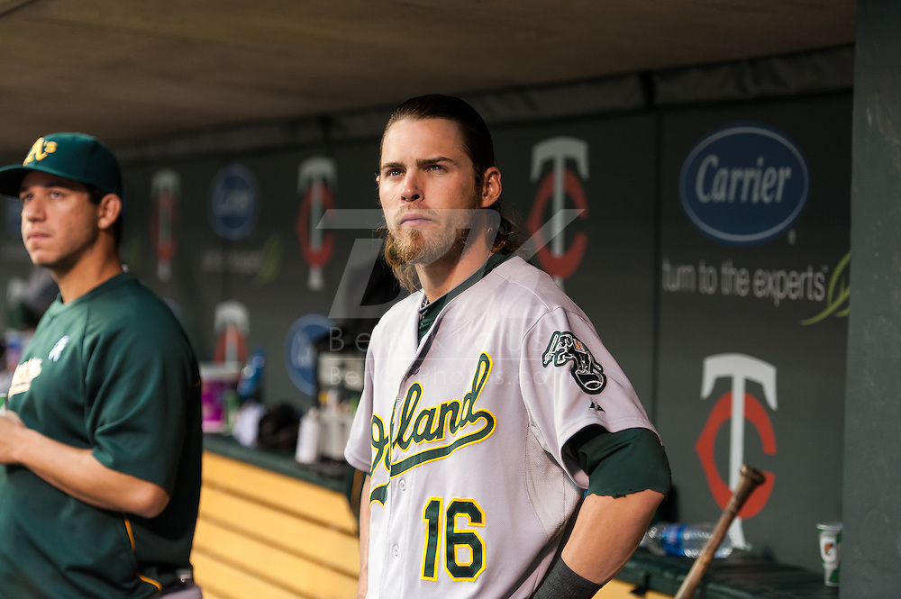 Oakland Athletics right fielder Josh Reddick looks on from the dugout before a game against the Minnesota Twins on July 13, 2012 at Target Field in Minneapolis, Minnesota.  The Athletics defeated the Twins 6 to 3.  © 2012 Ben Krause