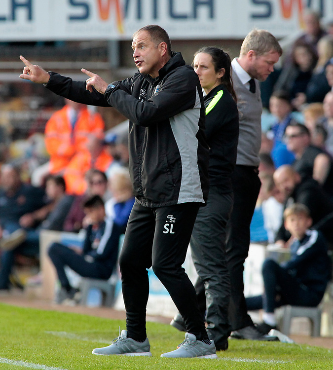 Gillingham caretaker manager Steve Lovell shouts instructions to his team from the dug-out<br /> <br /> Photographer David Shipman/CameraSport<br /> <br /> The EFL Sky Bet League One - Peterborough United v Gillingham - Saturday 14th October 2017 - London Road Stadium - Peterborough<br /> <br /> World Copyright © 2017 CameraSport. All rights reserved. 43 Linden Ave. Countesthorpe. Leicester. England. LE8 5PG - Tel: +44 (0) 116 277 4147 - admin@camerasport.com - www.camerasport.com