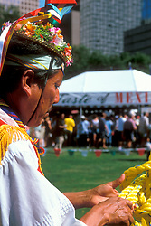 Stock photo of an older man in native clothing at the International Festival in downtown Houston Texas