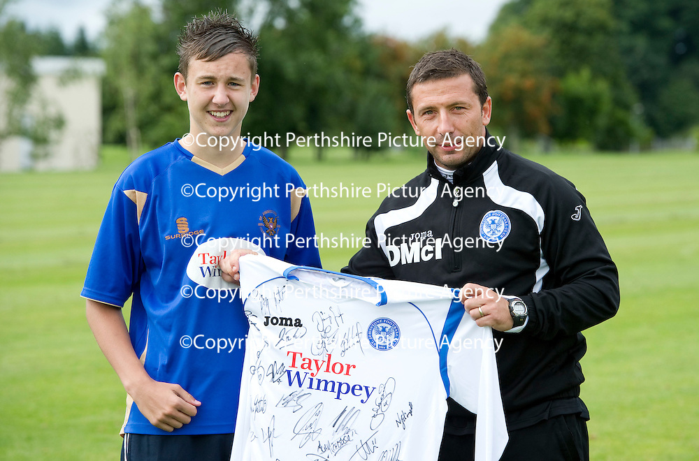St Johnstone Training.....28.07.10  Pre-Season Tour of Northern Ireland<br /> Fan Daniel Scott pictured being presented with a signed shirt from Derek McInnes after he won a penalty shootout against other fans against Graeme Smith and the trialist golakeeper<br /> <br /> see story by Gordon Bannerman Tel 07729 865788<br /> Picture by Graeme Hart.<br /> Copyright Perthshire Picture Agency<br /> Tel: 01738 623350  Mobile: 07990 594431