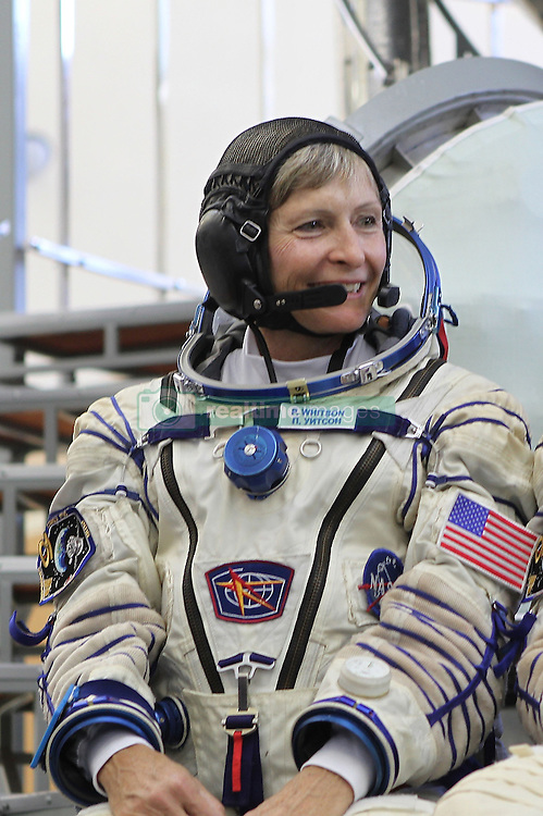 October 27, 2016 - File - Iowa native PEGGY WHITSON keeps piling up firsts in her long career as an astronaut. In two weeks, she will rocket into space again on her third mission to the International Space Station. She was its first female commander in 2007 and will become the first woman to ever command the space station twice. Combined with her 2002 mission, has logged the most days in space of any female in NASA history, 377. Pictured: May 26, 2016 - Star City, Russia - International Space Station Expedition 48 backup crew pose for photos at the Soyuz simulator in launch suits at the Gagarin Cosmonaut Training Center. NASA astronaut Peggy Whitson (Credit Image: © Stephanie Stoll/NASA/ZUMAPRESS.com)
