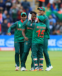 Bangladesh's Rubel Hossain (centre) celebrates after taking the wicket of New Zealand's Martin Guptill during the ICC Champions Trophy, Group A match at Sophia Gardens, Cardiff.