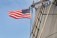 United States flag flying on Hawaiian Chieftain, a Square Topsail Ketch. Owned and operated by the Grays Harbor Historical Seaport, Aberdeen, Washington