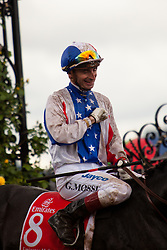 Gerald Mosse enters the mounting yard after winning the 2010 Melbourne cup riding the Alain de Royer Dupre trained horse 'Americain'
