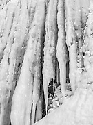 Black and white photograph, detail, of the Apostle Island Ice Caves, Makwike Bay, near Bayfield, Wisconsin, on a cold February day.