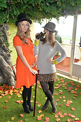 Left to right, JENNY POWELL and KELLY EASTWOOD at the 2014 Hennessy Gold Cup at Newbury Racecourse, Newbury, Berkshire on 29th November 2014.  The Gold Cup was won by Many Clouds ridden by Leighton Aspell.