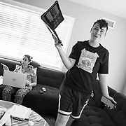 Spencer had to choose a online video workout from YouTube to take and record for his virtual Physical Education class while Erin works from the couch after suffering a painful pinched-nerve overnight. Spencer wasn't happy with the options.