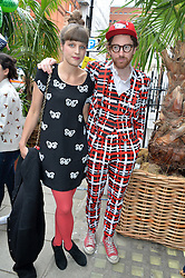 PHILIP & CHARLOTTE COLBERT at the launch of the new collection from Limoland held at Anderson & Sheppard's Haberdashery, 17 Clifford Street,London on 16th June 2014.