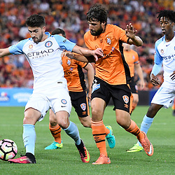BRISBANE, AUSTRALIA - OCTOBER 30: Thomas Broich of the Roar competes for the ball with Paulo Retre of Melbourne during the round 5 Hyundai A-League match between the Brisbane Roar and Melbourne City at Suncorp Stadium on November 4, 2016 in Brisbane, Australia. (Photo by Patrick Kearney/Brisbane Roar)