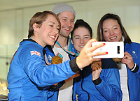Team GB PyeongChang 2018 Winter Olympics Homecoming - Heathrow Airport, Terminal Five<br /> <br /> Lizzie Arnold does a 'selfie' with the other GB  medalists arrives home from the Games.<br /> <br /> COLORSPORT/ANDREW COWIE