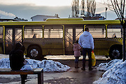 Passengers waiting at the tram endstation Ilidža for further connections with busses to other Sarajevo suburbs and outside villages. Ilidža is a municipality of Sarajevo Canton in central Bosnia and Herzegovina. It has a metro population of 157,654 and is a chief suburb of Sarajevo and de facto its neighborhood .