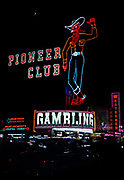 CS01059-03. Vegas Vic neon sign on the Pioneer Club in Las Vegas, Nevada. Erected in 1951. Photo July 1958. <br /> Silver Queen Bar, Sands Hotel & Casino, Las Vegas Nevada, July 1958.  The Sands Hotel & Casino opened in 1952. In 1967, a circular 17 story building was added, making The Sands the tallest structure on the Strip at the time. The Sands was imploded in 1996 to make way for the Venetian Hotel & Casino.