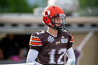 KELOWNA, BC - AUGUST 17:  Dominic Britton #12 of Okanagan Sun stands at the sidelines against the Westshore Rebels at the Apple Bowl on August 17, 2019 in Kelowna, Canada. (Photo by Marissa Baecker/Shoot the Breeze)