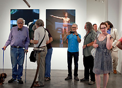 02 October 2014. Jonathan Ferrara Gallery, New Orleans, Louisiana. <br /> Artist Brian Borello (mid in blue) at the Jonathan Ferrara Gallery opening of the show 'Guns In The Hands Of Artists.' The show brings together over 30 internationally acclaimed artists who took parts from 190 destroyed weapons acquired by the New Orleans Police department  and converted them into art.  <br /> Photo; Charlie Varley/varleypix.com