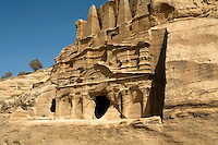 Caves carved into sandstone mountains in Petra, Jordan.
