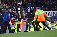 a pitch invader is caught by the security staff. The Emirates FA cup, 3rd round match, Everton v Dagenham & Redbridge at Goodison Park in Liverpool on Saturday 9th January 2016.<br /> pic by Chris Stading, Andrew Orchard sports photography.