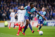 Anthony Stewart of Wycombe Wanderers passes under pressure during the EFL Sky Bet League 1 match between Wycombe Wanderers and Portsmouth at Adams Park, High Wycombe, England on 6 April 2019.