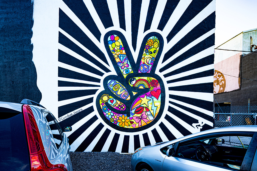 Hippie, flower power symbols from the 1960s in a Wynwood mural designed  by Corey Page for Miami Art Week 2017
