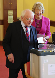 President Michael D Higgins and his wife Sabina cast their votes at the polling station in St Mary's Hospital, Pheonix Park, Dublin, as the country goes to the polls to vote in the referendum on the 8th Amendment of the Irish Constitution.