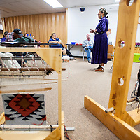 081613       Cable Hoover<br /> <br /> Lois Becenti talks about the history and tradition of weaving during a demonstration at Octavia Fellin Public Library in Gallup Friday.