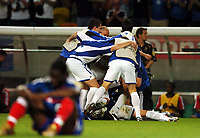 Team celebrate after final whistle as Louis Saha France in (Foreground)<br />Greece EURO 2004<br />France v Greece 25/06/04 Quarter Finals  <br />EURO 2004 PORTUGAL<br />Photo Robin Parker Fotosports International