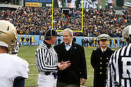 6 Dec 2008: President George W Bush greets an offical before the coin toss of the Army / Navy game December 6th, 2008. At Lincoln Financial Field in Philadelphia, Pennsylvania.