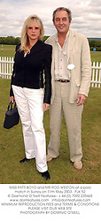 MISS PATTI BOYD and MR ROD WESTON at a polo match in Surrey on 11th May 2003.PJK 52