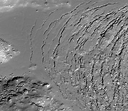 Frozen impact melt flows on the floor of Moore F, a farside highlands crater.
