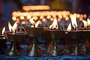 Butter lamps burn during Buddha Jayanti (Buddha's birthday) at Boudhanath Stupa, Kathmandu, Nepal on May 9, 2009.