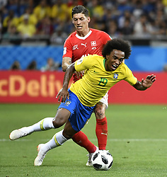 ROSTOV-ON-DON, June 17, 2018  Willian (front) of Brazil vies with Steven Zuber of Switzerland during a group E match between Brazil and Switzerland at the 2018 FIFA World Cup in Rostov-on-Don, Russia, June 17, 2018. (Credit Image: © Chen Yichen/Xinhua via ZUMA Wire)