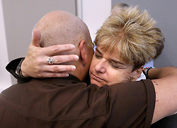 May 4, 2017 - Orlando, Florida, U.S. - Orlando city commissioner PATTY SHEEHAN embraces community activist TERRY DECARLO during a ceremony honoring the officers and staff involved in the response to the Pulse nightclub massacre Thursday. (Credit Image: © Joe Burbank/TNS via ZUMA Wire)