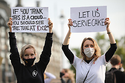 © Licensed to London News Pictures. 19/10/2020. London, UK. Workers in the hospitality sector protest in Parliament Square against the impact COVID-19 restrictions are having on the hospitality industry. Photo credit: Rob Pinney/LNP
