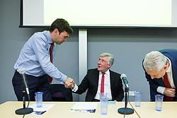 © Licensed to London News Pictures . 21/07/2016 . Manchester , UK . Candidates shake hands after a hustings for the Mayoralty of Greater Manchester , at the Renold Building of the University of Manchester . L-R Labour candidates Andy Burnham ( MP for Leigh ) , Tony Lloyd ( current interim Mayor ) and  Ivan Lewis ( MP for Bury South ) debate their relative candidacies . Photo credit : Joel Goodman/LNP