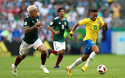 Mexico's Carlos Salcedo (left) gives chase to Brazil's Neymar