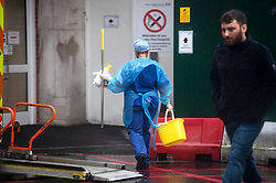 © Licensed to London News Pictures. 05/03/2020. London, UK. An NHS worker cleans out a coronavirus pod at Kings College Hospital in South London, where two patients have tested positive for coronavirus. New cases of the COVID-19 strain of Coronavirus are being reported daily as the government outlines it's plans for controlling the outbreak. Photo credit: Ben Cawthra/LNP