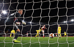 Arsenal's Shkodran Mustafi (centre) scores his side's second goal of the game during the UEFA Europa League round of 32 second leg match at the Emirates Stadium, London.