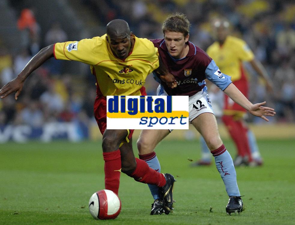 Photo: Richard Lane.<br />Watford v Aston Villa. The Barclays Premiership. 16/09/2006. <br />Watford's Damien Francis is challengrd by Villa's Stephen Davis.