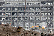TIANJIN, CHINA - AUGUST 24: (CHINA OUT) <br /> <br /> Chemical-defence Soldiers Detect Toxic Substance<br /> <br /> A digging machine works at Tianjin blasts scene on August 24, 2015 in Tianjin, China. The death toll from the Tianjin warehouse explosions two weeks ago has risen to 139, and 34 others remain missing, rescue authorities said on Wednesday.<br /> ©Exclusivepix Media