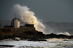 © Licensed to London News Pictures. 31/10/2020. Porthcawl, Bridgend, Wales, UK. Gale force winds and massive waves batters the small Welsh seaside resort of Porthcawl in Bridgend, UK. Photo credit: Graham M. Lawrence/LNP